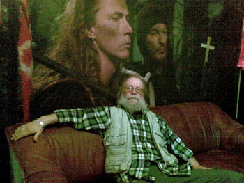 Sigge Viking is chillin in my new studio sofa in front of my little discreet wallpaper.. an ad for a film i acted in some years ago..me and Olle Ljungström were chimney sweepers and Ernst Billgren made the film